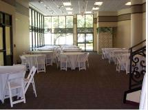 Setup at Welder Center with Round Tables and White Resin Chairs